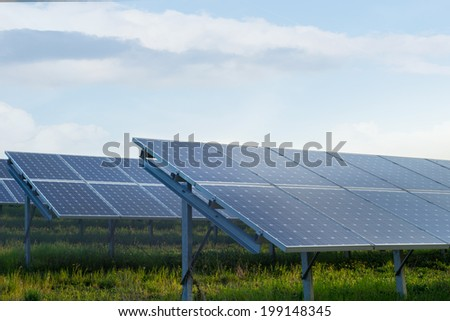 Solar power station in a field - stock photo