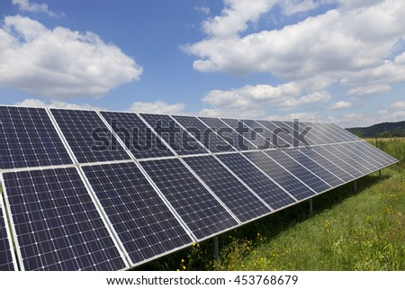 Solar Power Station on the summer flowering Meadow