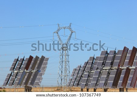 Solar power station with power pole - stock photo