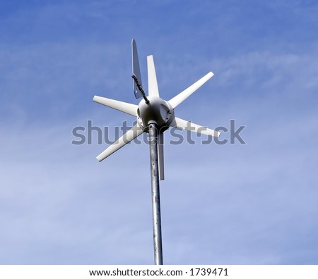 Solar powered environment friendly wind turbine over a blue sky background.