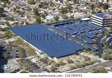 Solar powered parking structure with aerial view - stock photo