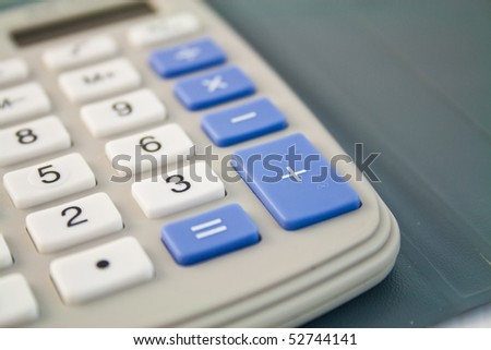 Solar reckoner with white and blue buttons - stock photo