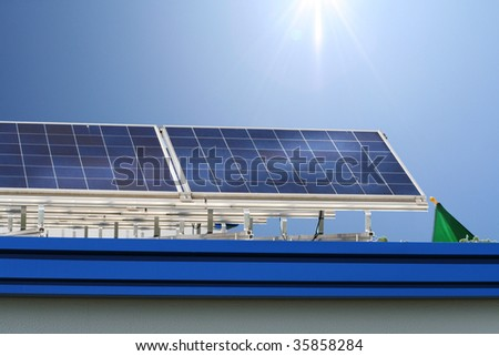 solar rows with sunny sky on a rooftop - stock photo