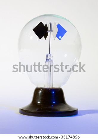 Solar spinner with white background and blue lighted base. - stock photo