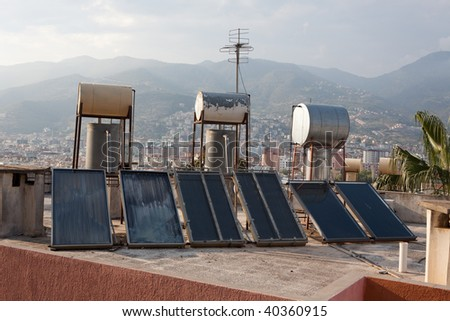 Solar thermal collectors for water heating on the roofs of Alanya, Turkey - stock photo