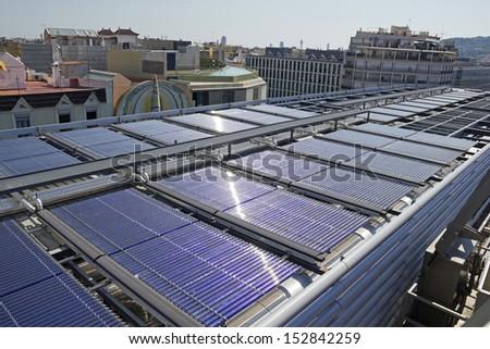 Solar vacuum tube in an urban building, greater energy efficiency. - stock photo