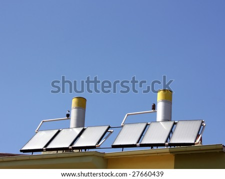 Solar water heating panels on a house roof - stock photo