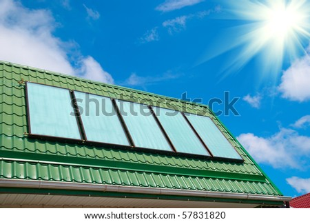 Solar water heating system on the roof. - stock photo
