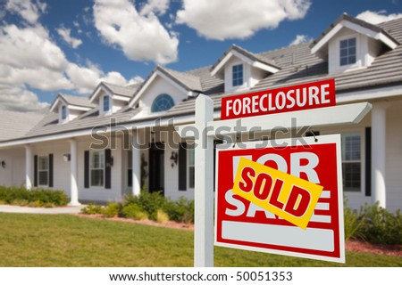 Sold Foreclosure Home For Sale Real Estate Sign in Front of New House -  Right Facing. - stock photo