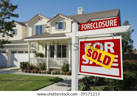 Sold Foreclosure Home For Sale Sign in Front of Beautiful House. - stock photo