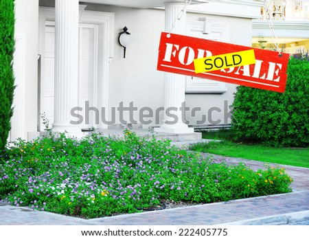 Sold home for sale real estate sign and beautiful new house - stock photo