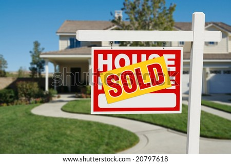 Sold Home for Sale Real Estate Sign and House - stock photo