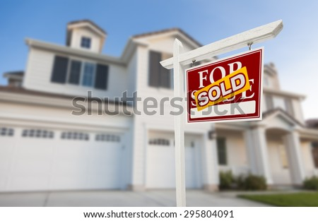 Sold Home For Sale Real Estate Sign in Front of Beautiful New House. - stock photo