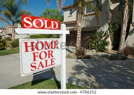 Sold Home For Sale Sign in Front of Beautiful New Home. See my theme variations. - stock photo