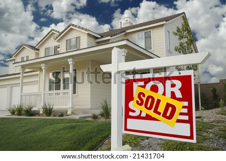 Sold Home For Sale Sign in Front of New House - stock photo