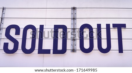 Sold out billboard on a concert venue in blue on white background - stock photo