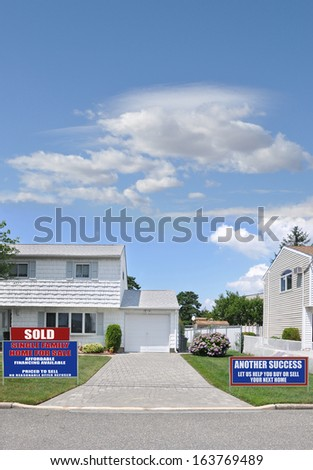 Sold Real Estate Sign Another Success Let Us Help You Buy Sell Your Next Home Suburban High Ranch Home Brick Driveway Residential Neighborhood Street Blue Sky Clouds USA - stock photo