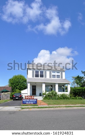 Sold Real Estate Sign Suburban Home Residential Neighborhood USA blue sky clouds - stock photo