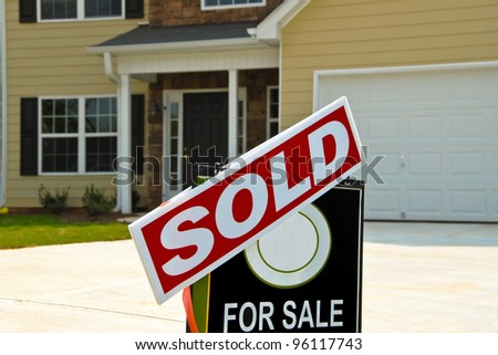 SOLD Sign in Front of Beautiful New Home - stock photo
