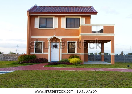 Sold Single family yellow orange  house with cyan sky background. - stock photo