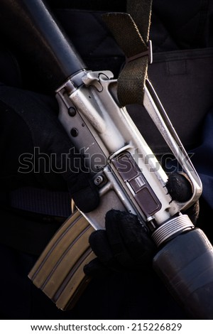Solder Holding a Machine Gun - stock photo