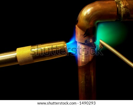 Soldering A Pipe - stock photo