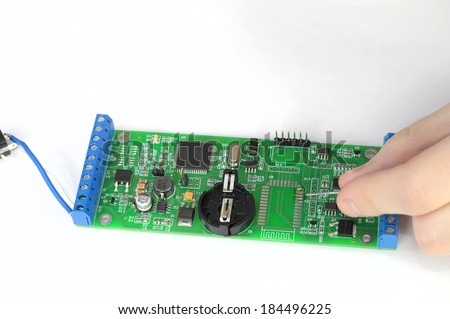 Soldering and repairing pc board - stock photo