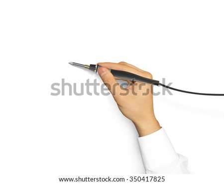 Soldering iron holding hand isolated. Soldering-iron electronic equipment hold in hands. Solder repair on hot temperature. Welding electrical instrument. Soldering tool with power. - stock photo