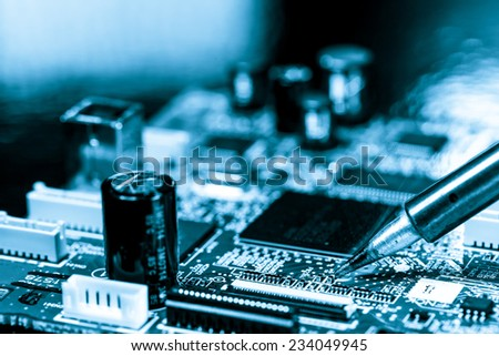 soldering of electronic circuit board - stock photo