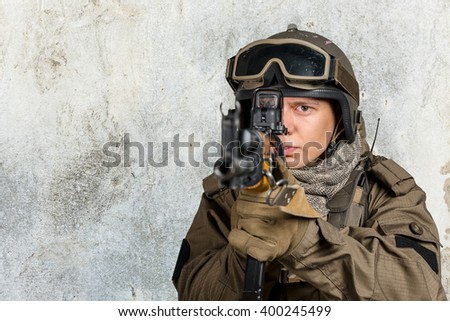 Soldier aiming a rifle at you - stock photo