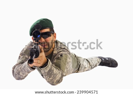 Soldier aiming with a sniper riffle SVD - S type in prone position with green beret isolated over white background - stock photo