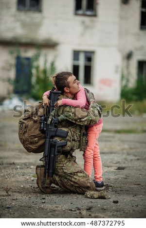 Soldier and children on battlefield background. Military and rescue operation concept.