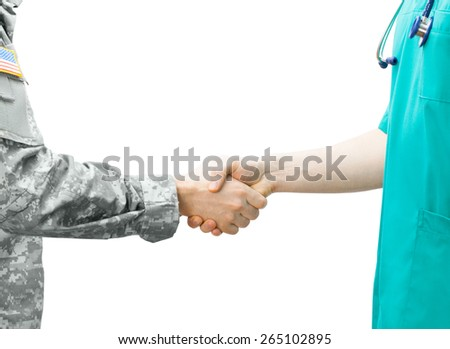 Soldier and doctor shaking hands - stock photo