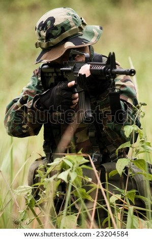 soldier at war in the jungle - stock photo