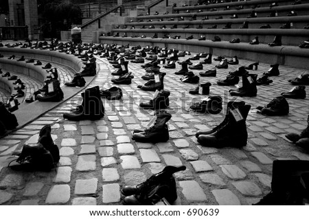 "Soldier boots standing at attention. Images from the AFSC travelling exhibition ""Eyes wide shut"". - stock photo"