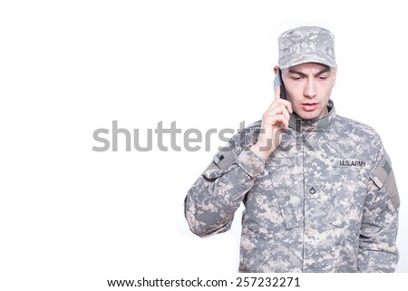 Soldier Calls Home on Cell Phone, bad news - stock photo