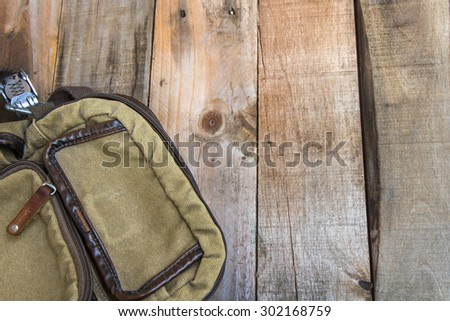 Soldier canvas bag on wood background - stock photo