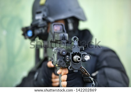 soldier carrying m-16 - stock photo