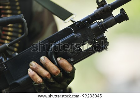 soldier carrying m-60 - stock photo