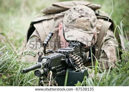 Soldier defending his position - stock photo