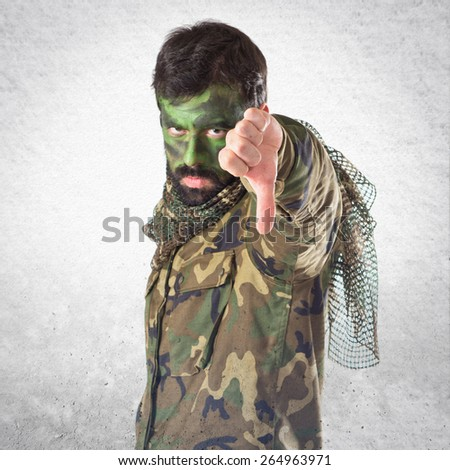 Soldier doing bad signal  - stock photo