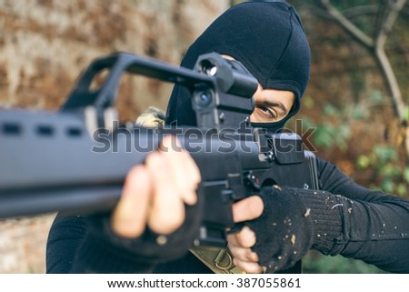Soldier fighting on the enemy land. concept about warfare and terrorism. Soft air player shooting with his rifle - stock photo
