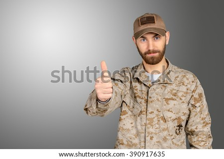 Soldier gesturing thumbs up - stock photo