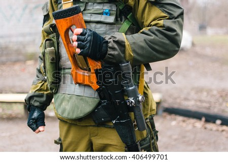 soldier holding a sniper rifle, standing in ranks, combat training, sniper rifle edge - stock photo