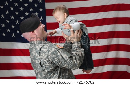 Soldier holding his son in the air - stock photo