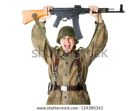 Soldier holding machine gun over head isolated on white background - stock photo