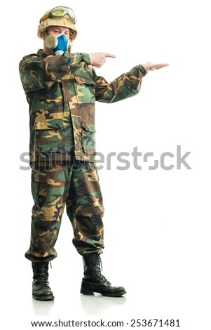 Soldier in camouflage and a respirator - stock photo