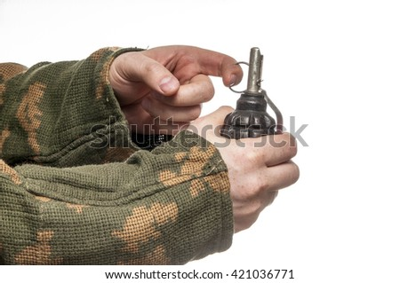 Soldier in camouflage hold the fragmentation grenade - stock photo