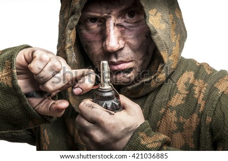 Soldier in camouflage hold the fragmentation grenade
