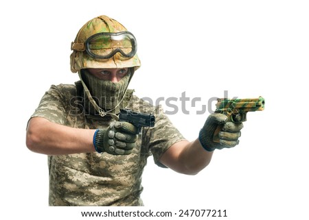 Soldier in camouflage with a gun